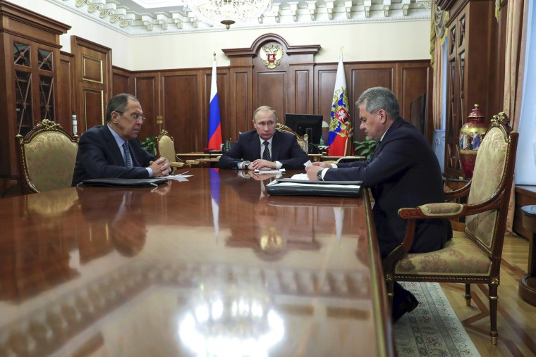 Image: Russian President Vladimir Putin, center, and Foreign Minister Sergey Lavrov, left, listen to Defence Minister Sergei Shoigu in Moscow, Russia, Dec. 29, 2016.