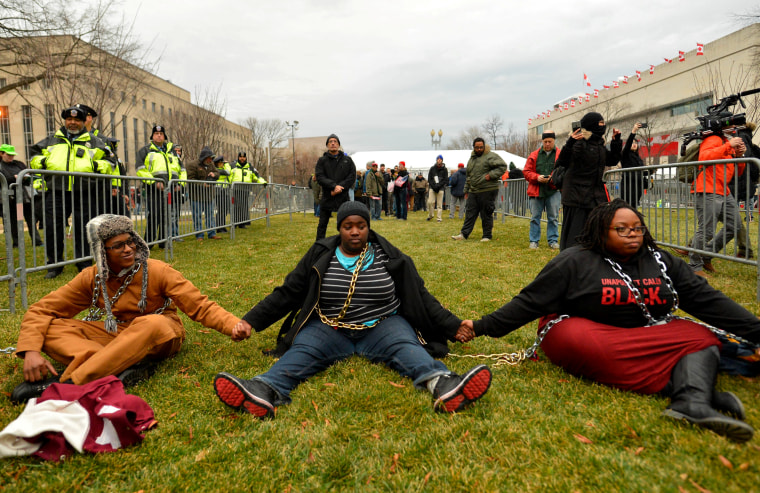 Image: Protesters chain themselves to each other and block an entry point prior to the inauguration, Jan. 20.