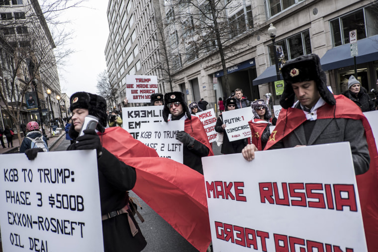 Image: Protesters dressed as a communist party participate in demonstrations.