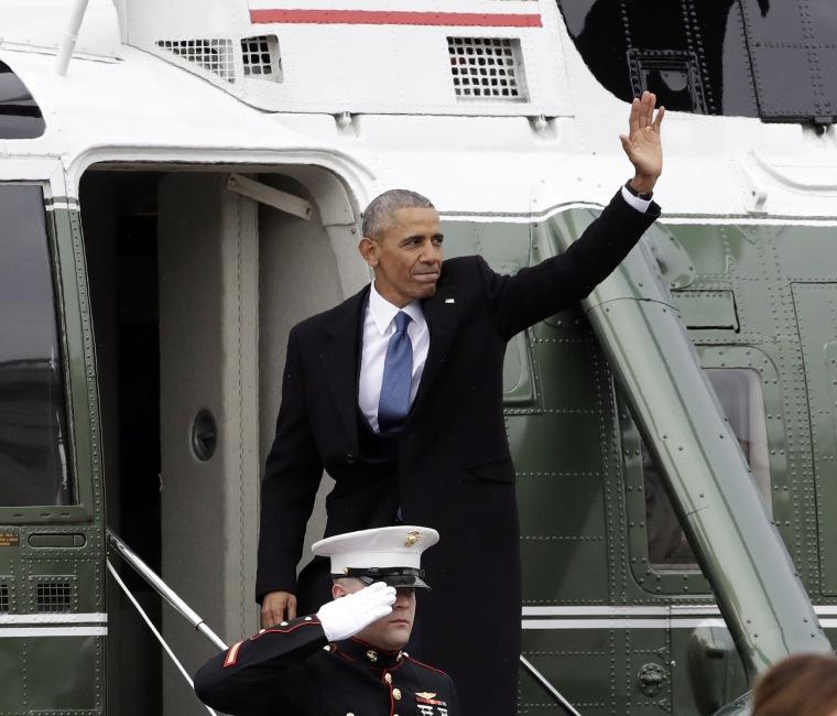 Image: Former President Barack Obama waves as he boards a Marine helicopter