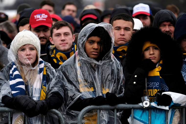 Image: The crowd on the National Mall reacts as U.S. President Donald Trump delivers his inaugural address in Washington