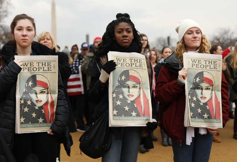 Image: People watch on the National Mall the inauguration of US President Donald Trump