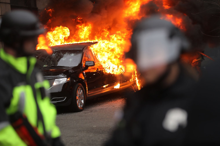 Image: Police and demonstrators clash in downtown Washington, D.C. after a limo was set on fire following the inauguration of President Donald Trump on Jan. 20.