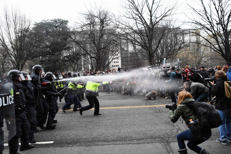 Image: Police pepper spray at anti-Trump protesters during clashes in Washington, D.C. on Jan. 20.
