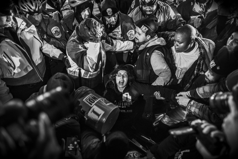 Image: Protesters scuffle with police after refusing to vacate the sidewalk in front of the National Press Club Building on Jan. 20.