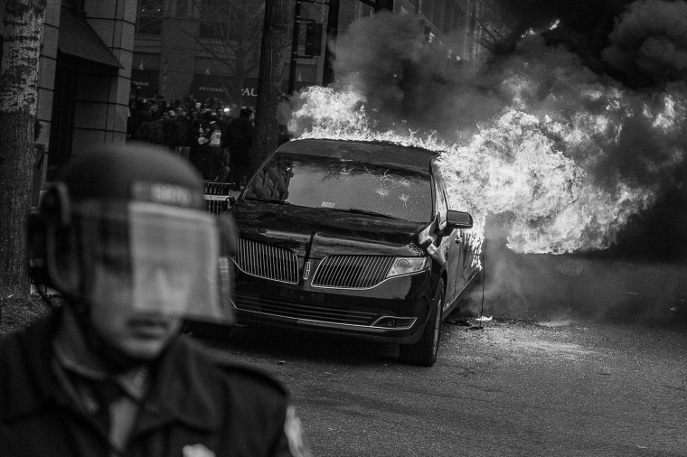 Image: A parked limousine burns during a demonstration after the inauguration of President Donald Trump on Jan. 20.