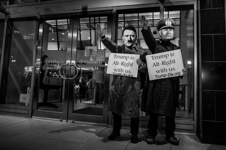 "Image: Protesters demonstrate in front of the National Press Club Building during the ""DeploraBall"" ahead of the presidential inauguration on Jan. 19."