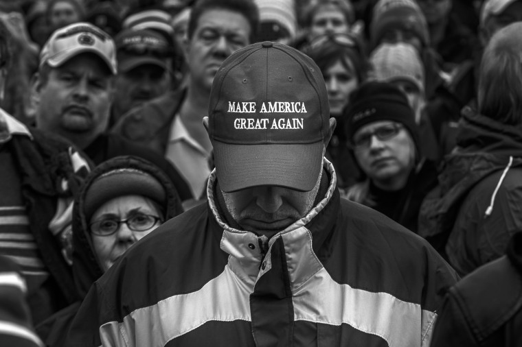 Image: Donald Trump supporters listen to his inaugural speech on Jan. 20.