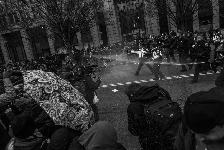 Image: Police use pepper spray against protesters on Jan. 20.