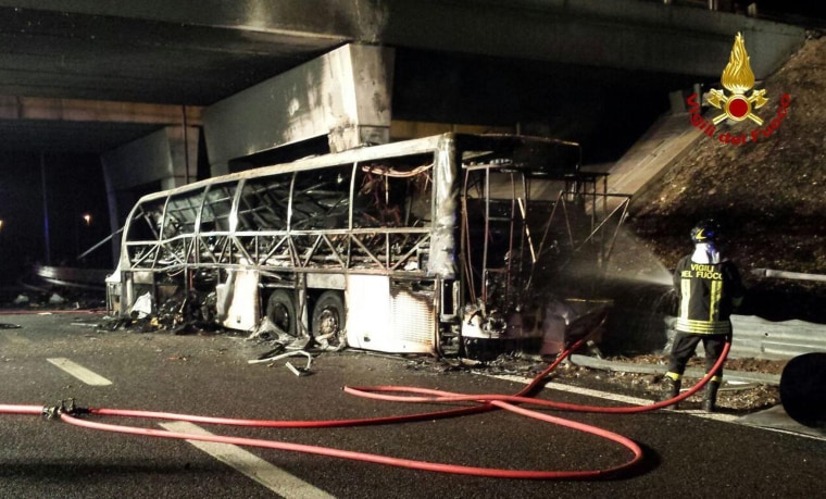 Image: A handout image from Italian firefighters shows the burned Hungarian bus after on the A4 highweay near Verona, Italy.