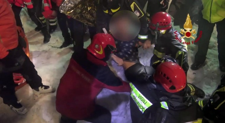 Image: Firefighters pull more survivors from the Hotel Rigopiano in Farindola, early Saturday. (Editors' note: Faces pixelated by source)