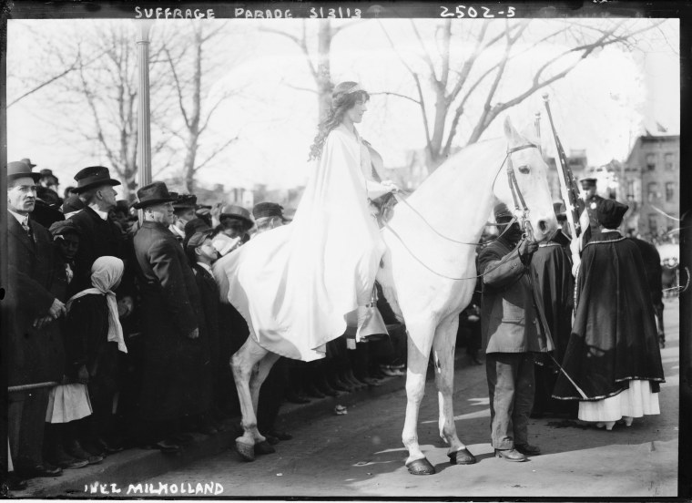 Image: Attorney Inez Milholland Boissevain rides astride the suffrage parade in as the first of four mounted heralds.
