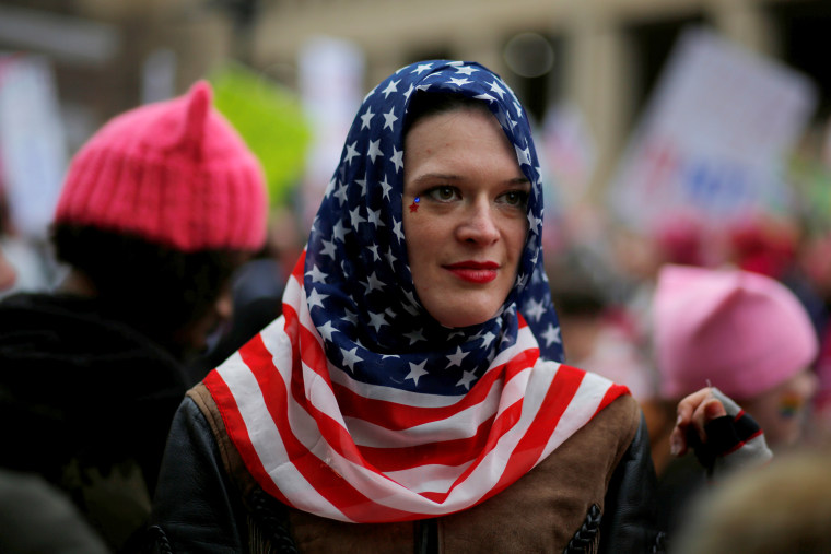 Image: A woman wears a U.S. flag scarf during the Women's March on Washington, following the inauguration of U.S. President Donald Trump, in Washington, DC, Jan. 21, 2017.