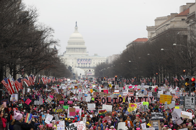 Image: Protesters march down Pennsylvania avenue during the Women's March on Washington, Jan. 21, 2017 in Washington, DC.