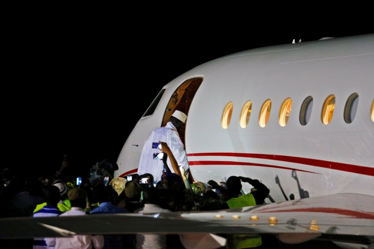 Image: Former Gambian president Yahya Jammeh boards a private jet before departing Banjul into exile