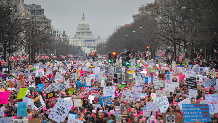 Image: Hundreds of thousands march down Pennsylvania Avenue during the Women's March in Washington