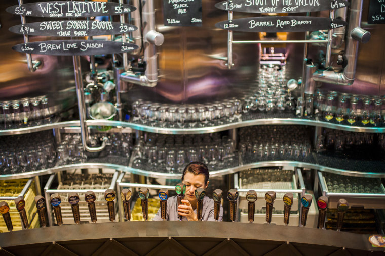 Image: A bartender at Sierra Nevada Brewing Company pours a beer for a customer at the brewery's taproom in Mills River, North Carolina on July 11, 2016.