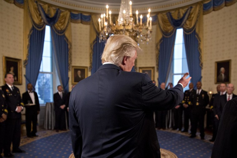 Image: Trump speaks during an Inaugural Law Enforcement Officers and First Responders Reception in the Blue Room of the White House on Jan. 22.