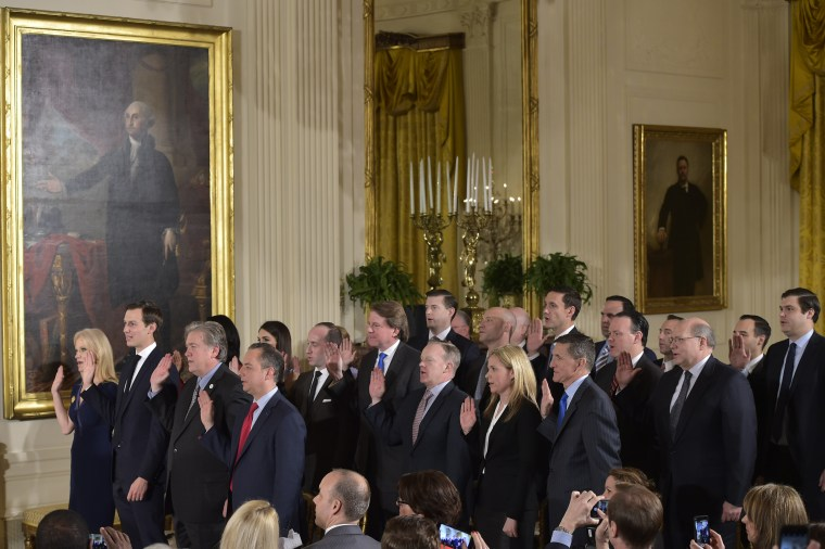 Image: The White House senior staff is sworn in.