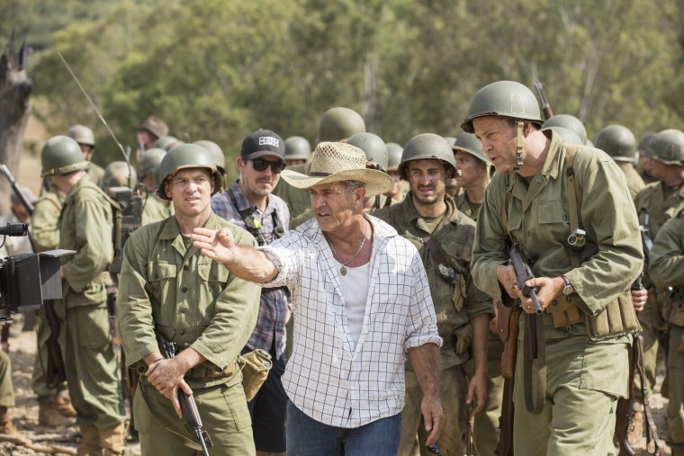 From left to right: Sam Worthington, Director Mel Gibson, and Vince Vaughn on the set of HACKSAW RIDGE