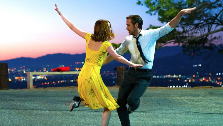 """Image: Emma Stone and Ryan Gosling on the set of """"La La Land."""""""