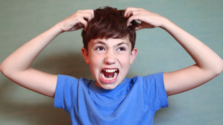 Boy screams, is angry, upset.