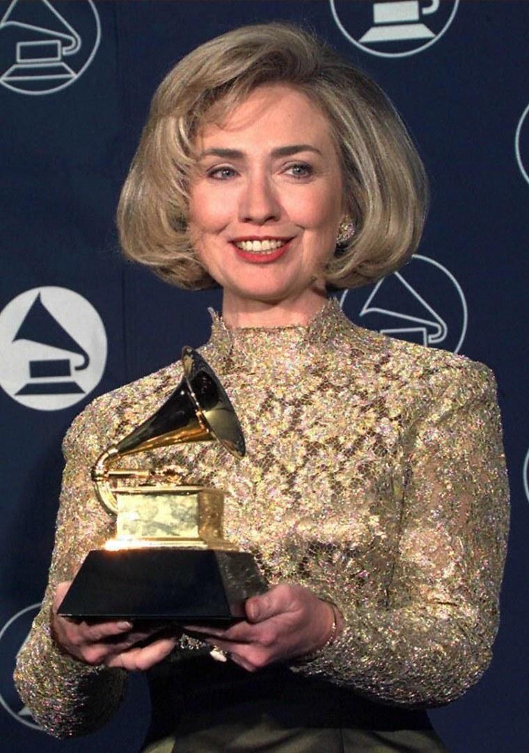 Hillary Rodham Clinton holds up her Grammy Award