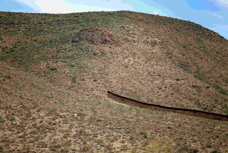 Image: A gap in the U.S.-Mexico border fence is seen outside Jacumba