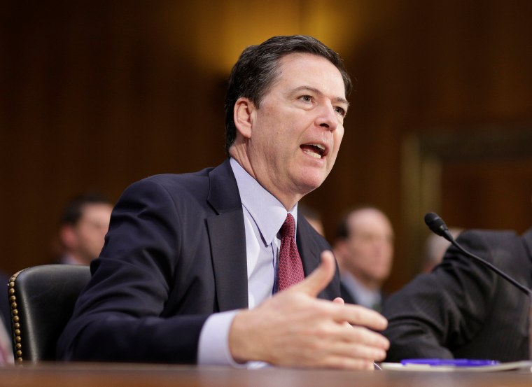 """Image: FBI Director James Comey testifies to the Senate Select Committee on Intelligence hearing on ?EURoeRussia?EUR(TM)s intelligence activities\"""" on Capitol Hill in Washington"""