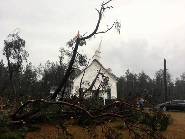 Image: Fallen trees sit near Zoar United Methodist Church, which sustained damage to its steeple, Jan. 22, near Baxley, Georgia.