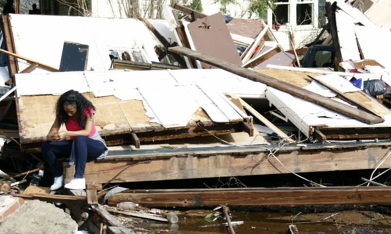 Image: Shanise McMorris grieves on the slab of her Hattiesburg, Mississippi, home after an early tornado hit the city, Jan. 21.