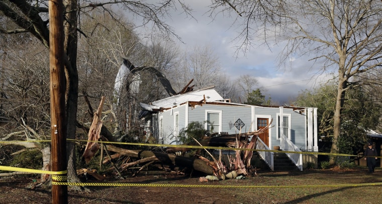 Image: Debris lies on the ground at the home of Ellen Green and Johnny Green, Jan. 22, in Opelika, Alabama.