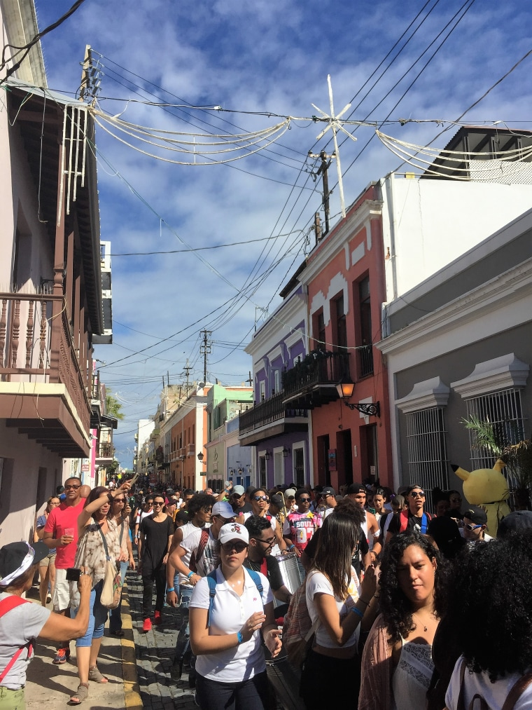 A view of the crowd walking down the Calle San Sebastian during the San Sebastian Festival in Old San Juan, P.R., Jan. 20, 2017.