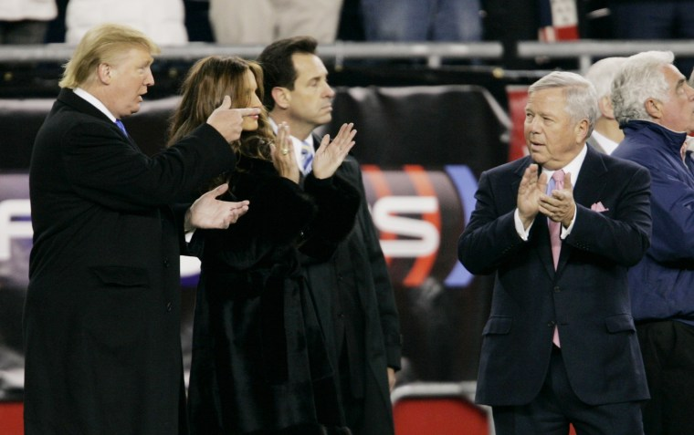 Donald Trump chats with New England Patriots owner Robert Kraft prior to the AFC Divisional NFL playoff football game against the Jacksonville Jaguars in Foxborough