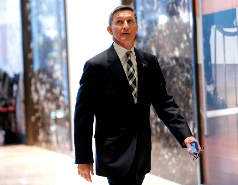 Image: Retired U.S. Army Lieutenant General Mike Flynn arrives to meet with U.S. President-elect Donald Trump at Trump Tower in New York City