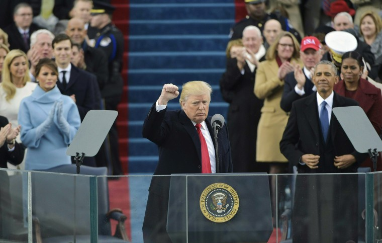 Image: Trump pumps his fist after addressing the crowd