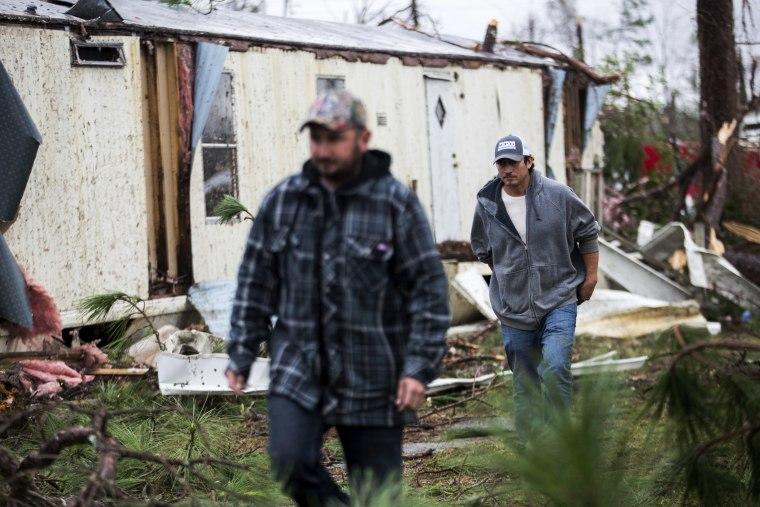 Image: Residents make their way through Big Pine Estates, Jan. 23, 2017, that was damaged by a tornado, in Albany, Ga.