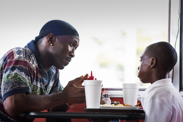 "Image: Mahershala Ali and Alex R. Hibbert in ""Moonlight."""