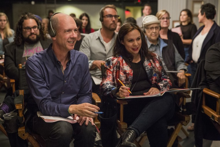 """Mike Royce and Gloria Calderon Kellett on the set of """"One Day At A Time."""""""