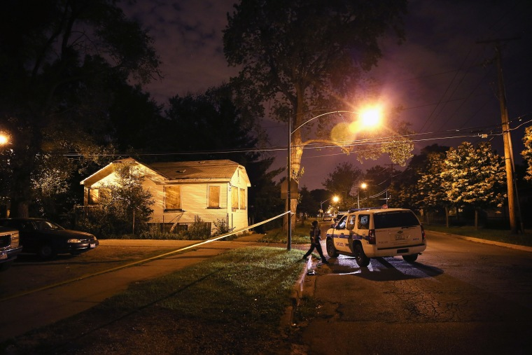 Image: Police collect evidence at the scene of a shooting on June 23, 2013 in Chicago, Ill.