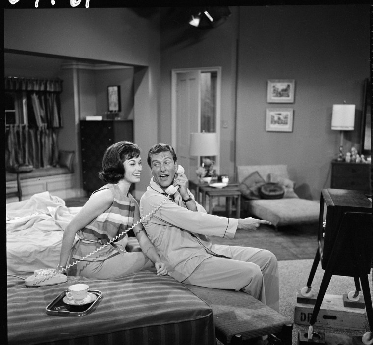 Image: Dick Van Dyke (as Rob Petrie) and Mary Tyler Moore (as Laura Petrie) film an episode in the Dick Van Dyke show on June 19, 1961.