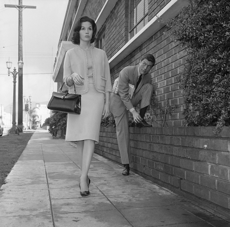 Image: Actor Dick Van Dyke, right, looks on as actress Mary Tyler Moore walks by, Feb. 22, 1962, Los Angeles, Calif.