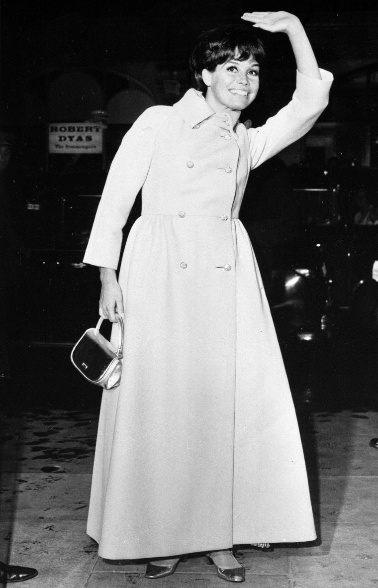 "Image: Actress Mary Tyler Moore waves to the crowd as she arrives for the premiere of ""Thoroughly Modern Millie"" at the Odeon St. Martin's Lane in London, Oct. 12, 1967."