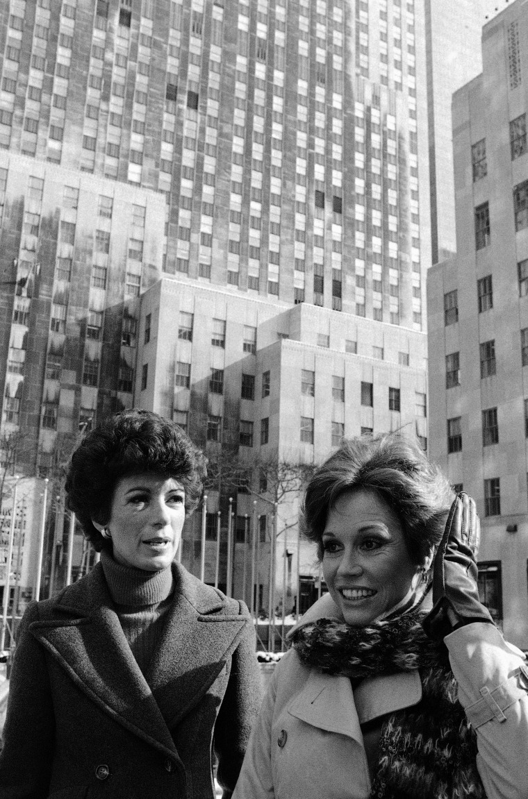 "Image: Actress Mary Tyler Moore, right, pats her hair into place, Feb. 16, 1978 prior to start of filming scene of ""First You Cry,"" in New York's Rockefeller Center."