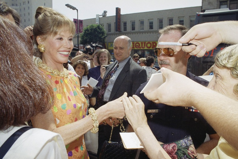 Image: Mary Tyler Moore signs an autograph, Sept. 8, 1992.