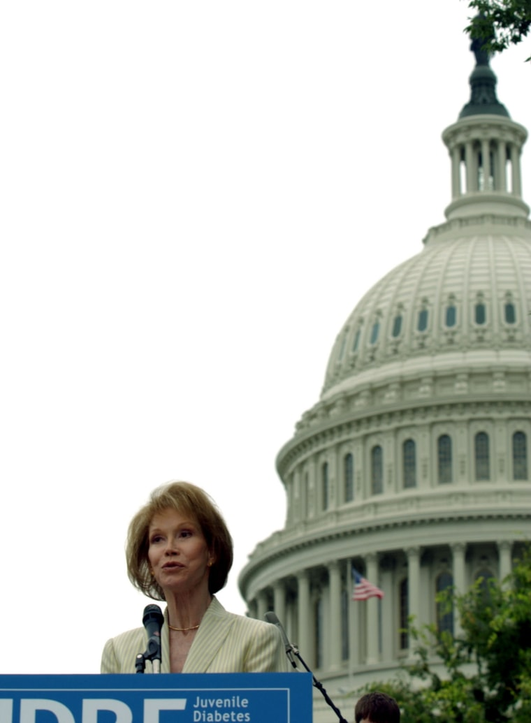 Image: Actress and International Chairman of the Juvenile Diabetes Research Foundation Mary Tyler Moore speaks outside the U.S. Capitol.