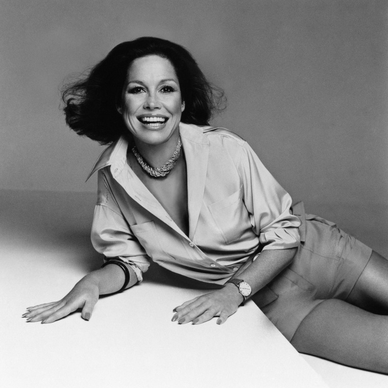 Image: Actress Mary Tyler Moore, is pictured lying on her side and smiling circa 1975.