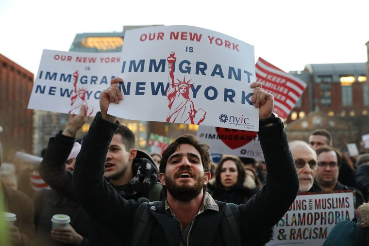 Image: Hundreds of people attend an evening rally at Washington Square Park in support of Muslims, immigrants and against the building of a wall along the Mexican border on Jan. 25, 2017 in New York City.