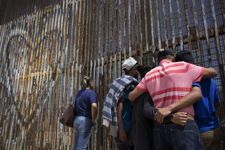 Image: Members of the Molina-Torres family talk to their relatives through the U.S.-Mexico border fence Playas de Tijuana, northwestern Mexico, on July 2, 2016.