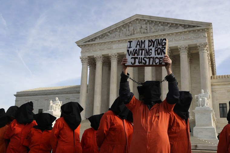 Image: Activist Rally And March Calling For Closure Of Guantanamo Bay Detention Facility